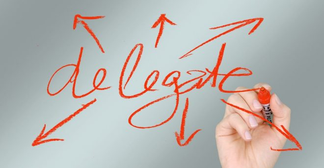 hand-writing-the-word-delegate